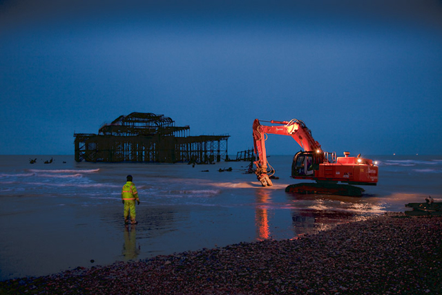 Removing remains of derelict West Pier at dawn, Brighton (The Guardian)
